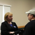 Tammy talks with invitees