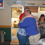 Winner, Susan Koehs, hugs Joe Burdick of Mathews Floor Fashions of Marquette