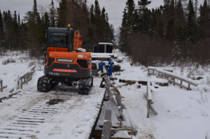Workers Replace Cracked Clowry Grade Bridge Support Beam along Snowmobile Trail No. 8 in Marquette County