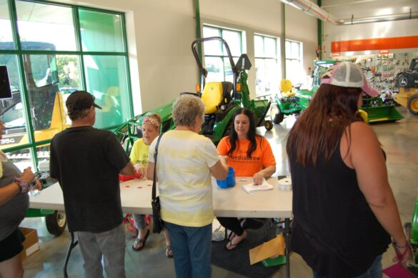 Abbie & Amy Registering Peopl at the mediaBrew Runs Like A Deere Giveaway Party