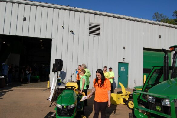 Amy Looking at the Grand Prize - John Deere x350 Riding Mower